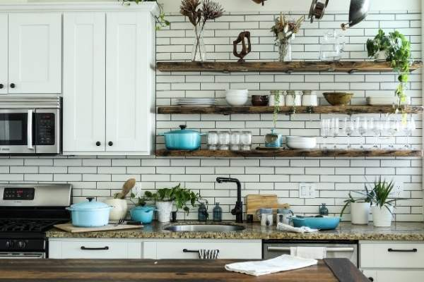 Kitchen counter with shelved and decor around it